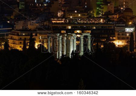 Athens Greece night view of Olympian Zeus temple ruins and city lights