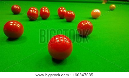 Bright colorful balls to play snooker on the table