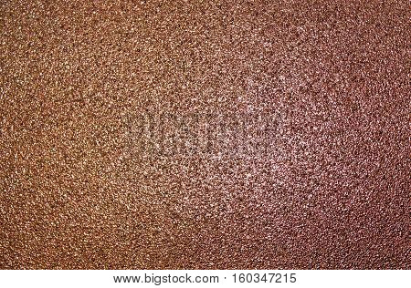 Abstract bronze texture, grunge background, grainy abstraction, brown texture, military background