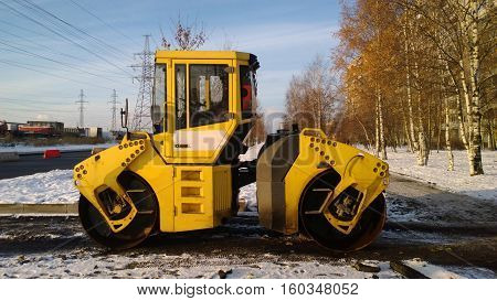 Russia, Saint-Petersburg - November 02, 2016: Road roller at a road construction site on a snowy day