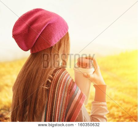 Young Woman Holding A Tumbler Of Coffee. Outdoor Portrait