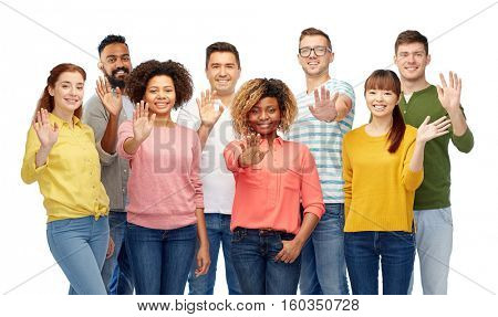 diversity, race, ethnicity and people concept - international group of happy smiling men and women waving hand over white
