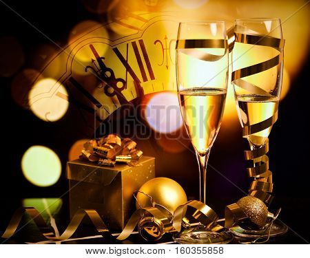 toasting with champagne glasses against holiday lights and clock close to midnight - New Year background