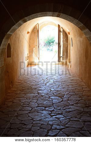 ARKADI, CRETE - SEPTEMBER 15, 2016 - Passageway with doors at the end in the Arkadi Monastery Arkadi Crete Greece Europe, September 15, 2016.
