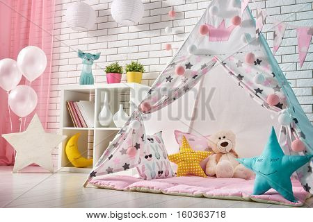 Spacious children room with play tent for girl.