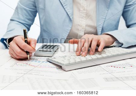Financial accounting Business woman using computer keyboard