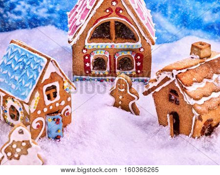 Fabulous village of gingerbread men and gingerbread houses. Snowfall and beautiful Christmas.