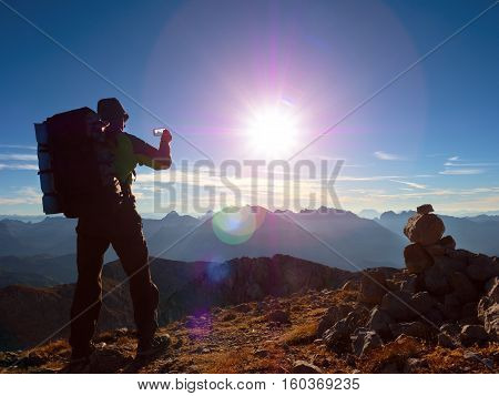 Lens Flare Defect. Hiker Takes Selfie Photo. Man With Big Backpack