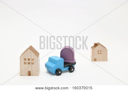 Grave is moving on a truck on white background. Image of moving grave.