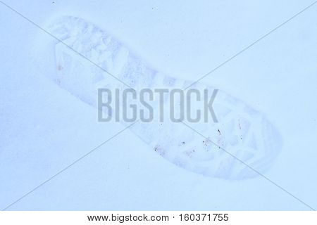 background with the image of footstep on a snow