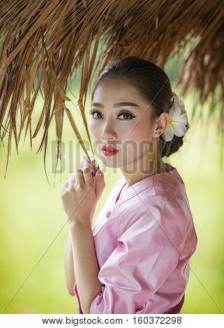 Beautiful Laos girl in Thai traditional costume.