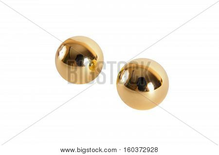 Golden vaginal balls isolated on white bacground