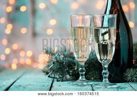 Christmas And New Year Celebration With Champagne. New Year Holiday Decorated Table. Two Champagne G