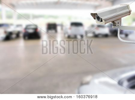 CCTV Camera on abstract blur packing car for background.