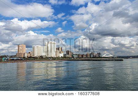 Ocean Blue Cloudy Sky And Golden Mile City Skyline