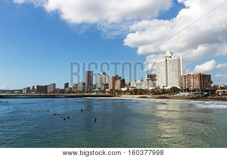 Ocean Blue Cloudy Sky And Golden Mile City Skyline
