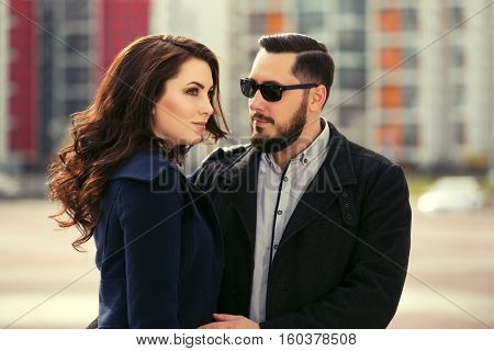 Young couple in love walking on city street. Male and female stylish fashion model outdoor