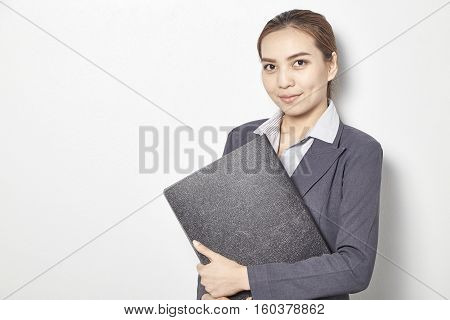 Young Business Women Holding File Standing