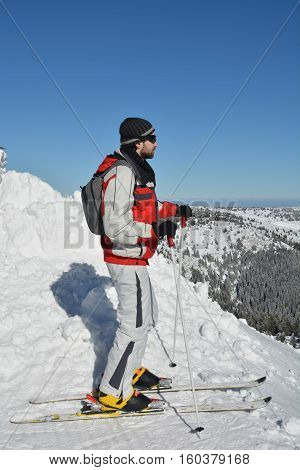 Ready young skier on the top of difficult ski concentrating and making plan where to pass