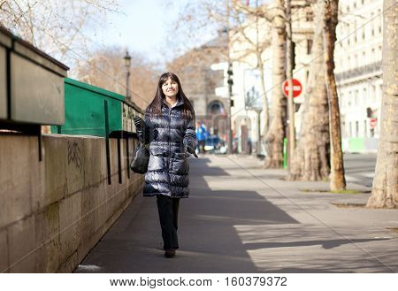 Pretty Brunette Female Tourist In Paris Walking By The Bookseller Boxes