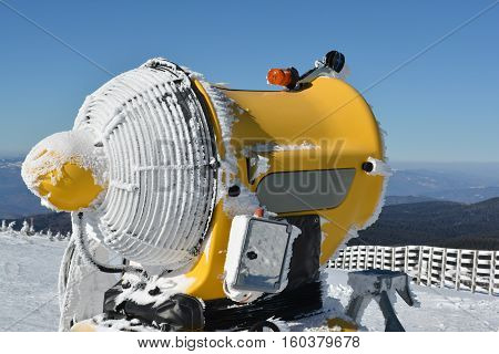 Snow gun with hoarfrost on the top of mountain Kopaonik Serbia side view close up
