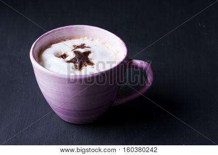 coffee, a cup of latte coffee on a black background