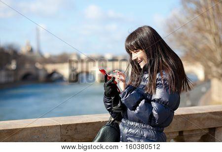 Happy Beautiful Brunette Tourist In Paris Sending An Sms