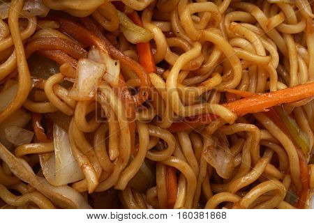 Chinese dish. Chinese food. Noodles with vegetables. Closeup.