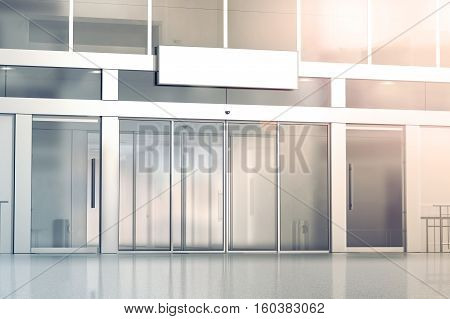 Blank white signage on the store glass doors entrance mockup 3d rendering. Commercial building automatic entry banner mock up. Closed transparent business centre facade front view.