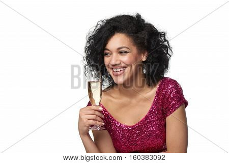 Party, drinks, holidays and celebration concept. Closeup happy playful laughing woman in sequined dress with glass of champagne looking to side at blank copy space