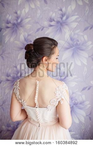 Beautiful young bride with wedding makeup and hairstyle in bedroom.. Closeup portrait of young gorgeous bride. Wedding hairstyle