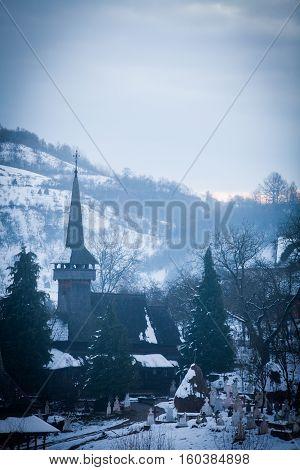 Color image of the wooden church in Poienile Izei Maramures region Romania.