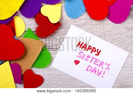 Happy Sister's Day greeting card. Colourful hearts and greeting card. Sister is your best friend. Palette of love.