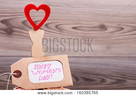 Happy Women's Day label card. Greeting paper and heart. Say many compliments to ladies. Day of beauty.