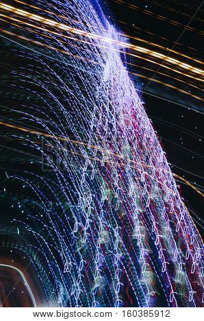Christmas tree image with light trace using a long time exposure. Abstraction with star at top. Night time