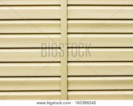 The siding background and texture.