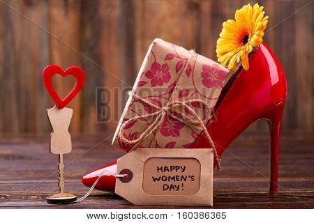 Women's Day tag and flower. Present box, shoe and heart. Express your appreciation and love. Design of a nice gift.