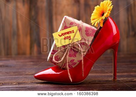 Women's Day card and gift. Shoe and flower on wood. Design a lovely gift. Presents for lady.