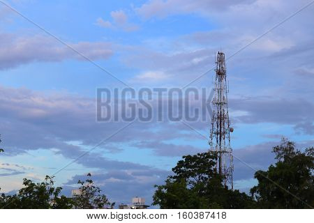 Telecommunication tower with antennas communication telecom radio telephone mobile phone in evening sky