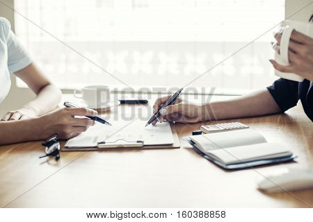 Two business people working with their documents in office