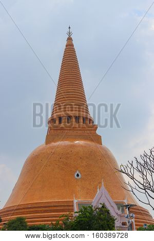 Temples beautiful Phra Pathom Chedi landmark of Thailand on blue sky background