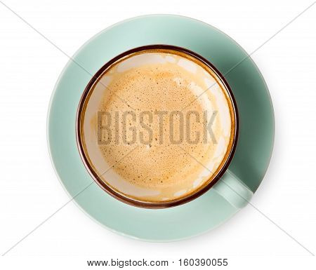 Cappuccino or latte with frothy foam, blue coffee cup top view closeup isolated on white background. Cafe and bar, barista art concept.