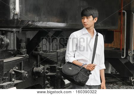 Portrait of handsome young man with train classic