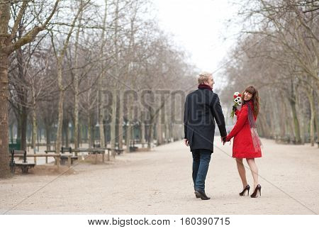 Cheerful Young Lady With Her Boyfriend In A Park