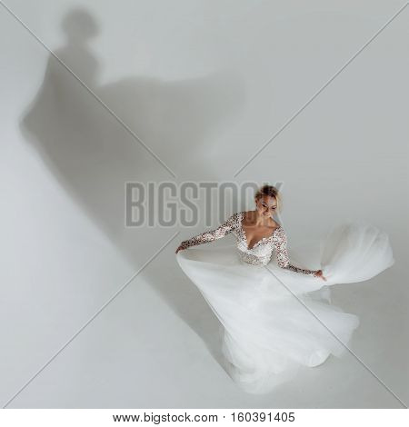 Beautiful bride in wedding dress, white background