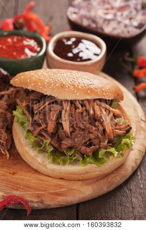 American pulled pork burger sandwich with bbq sauce