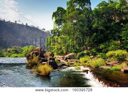 Scenic River With Crystal Clear Water Among Woods And Rocks