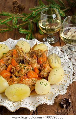 Roasted rabbit with herbs vegetables and white wine sauce. This rabbit stew is a savory combination of cut up rabbit carrots and potatoes.