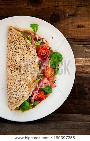 Buckwheat Pancakes With Cherry Tomatoes, Rocket Salad, Spinach, Parma Ham