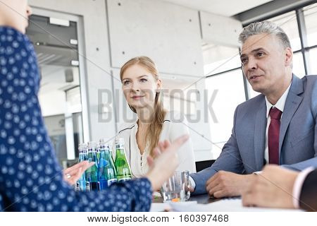 Business people having discussion in board room at office
